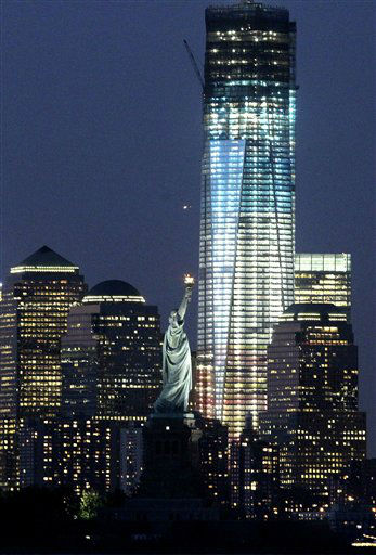 "<div class=""meta image-caption""><div class=""origin-logo origin-image ""><span></span></div><span class=""caption-text"">The Statue of Liberty, center right, and One World Trade Center, right, lit up in red, white and blue lights ahead of the Fourth of July holiday are seen from Bayonne, N.J., Monday, July 2, 2012. (AP Photo/Julio Cortez) (AP Photo/ Julio Cortez)</span></div>"