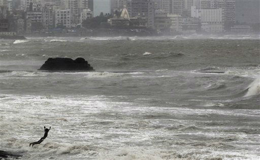 A boy jumps in to the Arabian Sea during a high tide after monsoon rains in Mumbai, India, Tuesday, July 3, 2012. The monsoon rains which usually hit India from June to September are crucial for farmers whose crops feed hundreds of millions of people. &#40;AP Photo&#47; Rajanish Kakade&#41; <span class=meta>(AP Photo&#47; Rajanish Kakade)</span>