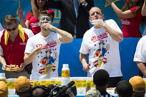Tim &#34;Eater X&#34; Janus, left, and five-time reigning champion Joey Chestnut, right, compete in the Nathan&#39;s Famous Hot Dog Eating World Championship, Wednesday, July 4, 2012, in the Brooklyn borough of New York. Chestnut won his sixth straight Coney Island hot dog eating contest.  &#40;AP Photo&#47;John Minchillo&#41; <span class=meta>(AP Photo&#47; John Minchillo)</span>