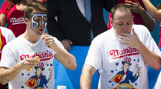 Tim &#34;Eater X&#34; Janus, left, and five-time reigning champion Joey Chestnut, right, compete in the Nathan&#39;s Famous Hot Dog Eating World Championship, Wednesday, July 4, 2012, in the Brooklyn borough of New York. Chestnut went on to scarf down 68 hot dogs to win his sixth consecutive Fourth of July hot dog eating contest at Coney Island. &#40;AP Photo&#47;John Minchillo&#41; <span class=meta>(AP Photo&#47; John Minchillo)</span>