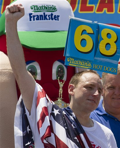 Five-time reigning champion Joey Chestnut celebrates after he wins his sixth Nathan's Famous Hot Dog Eating World Championship with a total of 68 hot dogs and buns, Wednesday, July 4, 2012, at Coney Island, in the Brooklyn borough of New York. (AP Photo/John Minchillo)