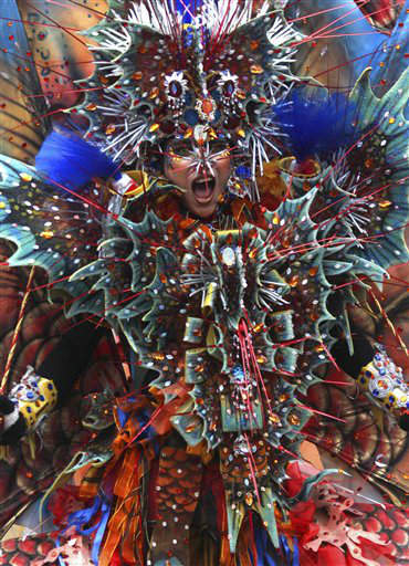"<div class=""meta ""><span class=""caption-text "">A model performs during Jember Fashion Carnival, an annual event to showcase creations by local fashion designers, in Jember, East Java, Indonesia, Sunday, July 8, 2012. (AP Photo/Trisnadi) (AP Photo/ Trisnadi)</span></div>"
