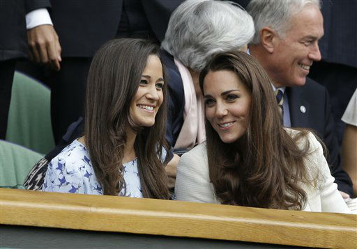Kate, Duchess of Cambridge, front right, speaks with her sister Pippa Middleton as they arrive to watch Roger Federer of Switzerland face Andy Murray of Britain during the men&#39;s final match at the All England Lawn Tennis Championships at Wimbledon, England, Sunday, July 8, 2012. &#40;AP Photo&#47;Kirsty Wigglesworth&#41; <span class=meta>(AP Photo&#47; Kirsty Wigglesworth)</span>