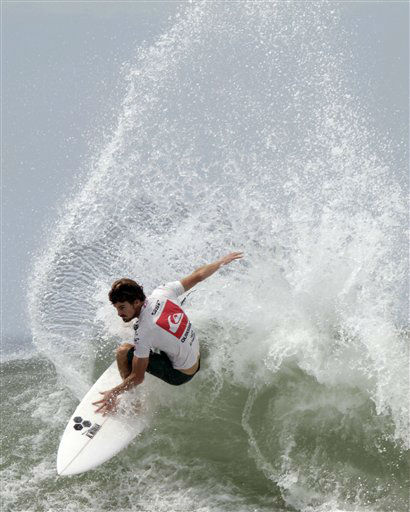"<div class=""meta ""><span class=""caption-text "">Surfer Hank  Gaskell, from U.S., competes to win the Quiksilver Cup at Punta Roca beach in La Libertad, El Salvador, Sunday, July 8, 2012. (AP Photo/Luis Romero) (AP Photo/ Luis Romero)</span></div>"