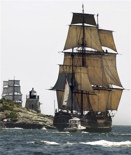 A replica of the historic ship HMS Bounty, right, sails past a lighthouse, center, as it departs Narragansett Bay and heads out to sea off the coast of Newport, R.I., Monday, July 9, 2012. The Ocean State Tall Ships Festival came to a close in Newport with a &#34;Parade of Sail&#34; along the east passage of Narragansett Bay as the majestic ships sailed out to sea. &#40;AP Photo&#47;Steven Senne&#41; <span class=meta>(AP Photo&#47; Steven Senne)</span>
