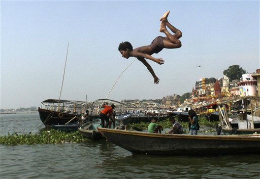 An Indian child dives into the River Ganges in Varanasi, India, Tuesday, July 10, 2012. Varanasi, also known as Kashi and Benaras, is Hinduism&#39;s holiest city. &#40;AP Photo&#47;Rajesh Kumar Singh&#41; <span class=meta>(AP Photo&#47; Rajesh Kumar Singh)</span>