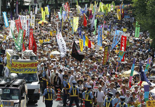 Anti-nuclear energy protesters march on a street in Tokyo Monday, July 16, 2012. Tens of thousands of people gathered at a Tokyo park, demanding ?Sayonara,? or goodbye, to nuclear power as Japan prepares to restart yet another reactor, and expressed outrage over a report that blamed culture on the Fukushima disaster. &#40;AP Photo&#47;Koji Sasahara&#41; <span class=meta>(AP Photo&#47; Koji Sasahara)</span>