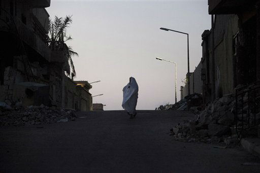A Libyan woman walks through the ruins in Sirte , Libya, Monday, July 16, 2012. Sirte, the hometown of the country&#39;s late dictator Moammar Gadhafi and the last regime stronghold to fall during the revolution last year still suffers from the effects of the Libyan civil war. &#40;AP Photo&#47;Manu Brabo&#41; <span class=meta>(AP Photo&#47; Manu Brabo)</span>