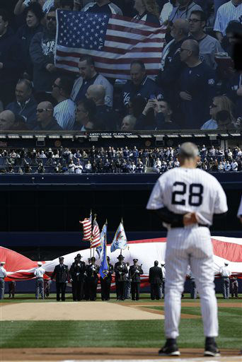 New York Yankees manager Joe Girardi &#40;28&#41; stands at attention as an honor guard performs a tribute to the victims of the Newtown, Ct., school shootings before an Opening Day baseball game at Yankee Stadium in New York, Monday, April 1, 2013.  &#40;AP Photo&#47;Kathy Willens&#41; <span class=meta>(AP Photo&#47; Kathy Willens)</span>