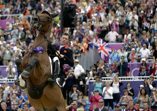 Hello Sanctos, the horse ridden by Scott Brash, of Great Britain, rears as the crowd cheers during a victory lap after Great Britain won the gold medal for the equestrian team show jumping at the 2012 Summer Olympics, Monday, Aug. 6, 2012, in London. &#40;AP Photo&#47;David Goldman&#41; <span class=meta>(AP Photo&#47; David Goldman)</span>