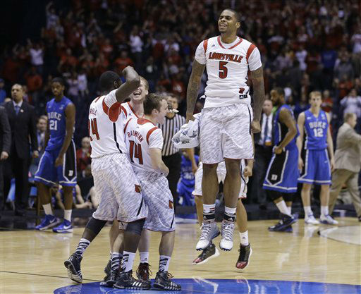 Louisville&#39;s Chane Behanan leaps in the air as he wears the jersey of injured teammate Kevin Ware as he and teammates celebrate their 85-63 win over Duke in the Midwest Regional final in the NCAA college basketball tournament, Sunday, March 31, 2013, in Indianapolis.  &#40;AP Photo&#47;Darron Cummings&#41; <span class=meta>(AP Photo&#47; Darron Cummings)</span>