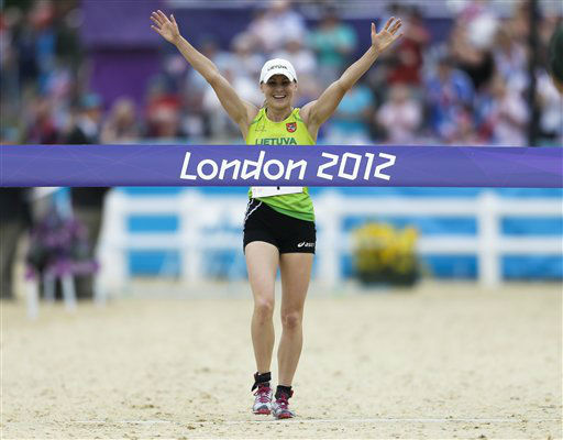 Laura Asadauskaite, of Lithuania crosses the finish line to win in the women&#39;s modern pentathlon, at the 2012 Summer Olympics, Sunday, Aug. 12, 2012, in London. &#40;AP Photo&#47;Markus Schreiber&#41; <span class=meta>(AP Photo&#47; Markus Schreiber)</span>