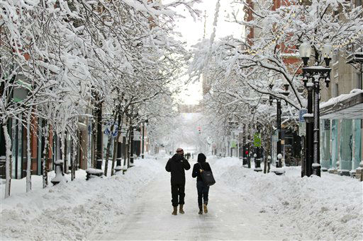 A couple walks down Westminster Street in downtown Providence, R.I., after a winter storm dumped two feet of snow on the area, Saturday, Feb. 9, 2013. &#40;AP Photo&#47;Stew Milne&#41; <span class=meta>(AP Photo&#47; Stew Milne)</span>