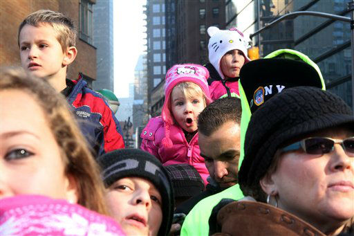 "<div class=""meta ""><span class=""caption-text "">Reagon Long, 3, from Oxford, N.Y, background center, watches the 86th Annual Macy's Thanksgiving Day Parade Thursday Nov. 22, 2012, in New York. The annual Macy's Thanksgiving Day Parade put a festive mood in the air in a city still coping with the aftermath of Superstorm Sandy.  (AP Photo/Tina Fineberg) (AP Photo/ Tina Fineberg)</span></div>"