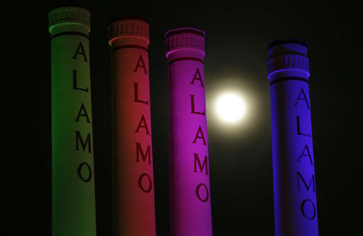 A hazy &#34;supermoon&#34; is seen behind lighted smoke stacks at the Alamo Quarry Markey, formerly a cement factory, Saturday, June 22, 2013, in San Antonio. The biggest and brightest full moon of the year graces the sky early Sunday as our celestial neighbor swings closer to Earth than usual. While the moon will appear larger than normal, sky watchers won&#39;t be able to notice the difference with the naked eye.&#40;AP Photo&#47;Eric Gay&#41; <span class=meta>(AP Photo&#47; Eric Gay)</span>