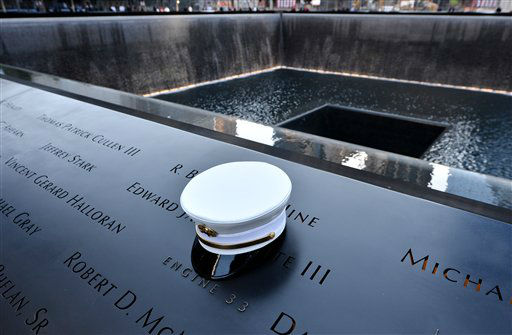 A firefighter&#39;s hat rests on names of firefighters at the south reflecting pool who died  in the attacks at the World Trade Center, during the 11th anniversary observance at the World Trade Center Memorial, in New York, Tuesday Sept. 11, 2012.  &#40;AP Photo&#47;Justin Lane. Pool, EPA&#41; <span class=meta>(AP Photo&#47; Justin Lane)</span>