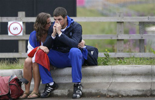 "<div class=""meta ""><span class=""caption-text "">Rower Julien Bahain, of France's men's double sculls team, is comforted by his girlfriend after his team finished fifth in a semifinal race and failed to advance to the final in Eton Dorney, near Windsor, England, at the 2012 Summer Olympics, Tuesday, July 31, 2012. (AP Photo/Chris Carlson) (AP Photo/ Chris Carlson)</span></div>"
