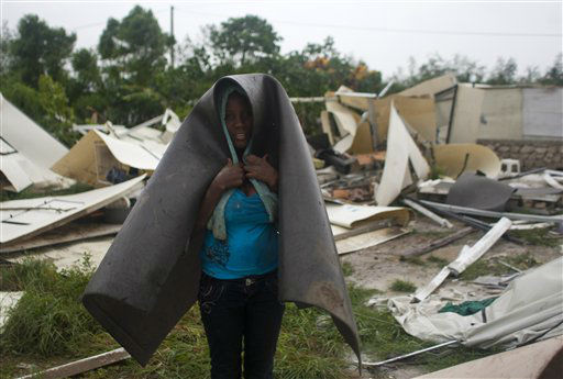A woman covers herself with what&#39;s left of her home in a camp set up for people displaced by the 2010 earthquake that was destroyed by Tropical Storm Isaac in Port-au-Prince, Haiti, Saturday Aug. 25, 2012. Tropical Storm Isaac swept across Haiti&#39;s southern peninsula early Saturday, dousing a capital city prone to flooding and adding to the misery of a poor nation still trying to recover from the 2010 earthquake. &#40;AP Photo&#47;Dieu Nalio Chery&#41; <span class=meta>(AP Photo&#47; Dieu Nalio Chery)</span>