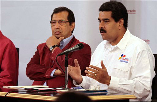 In this photo released by Miraflores Presidential Press Office, Venezuela&#39;s Vice President Nicolas Maduro, right, addresses the nation from Miraflores presidential palace as Governor Adan Chavez, the older brother of President Hugo Chavez, looks on in Caracas, Venezuela, Tuesday, March 5, 2013. Maduro met with top Venezuelan government ministers, the military high command and all 20 loyalist governors in Caracas following word of President Hugo Chavez&#39;s deteriorating health. &#40;AP Photo&#47;Miraflores Presidential Press Office&#41; <span class=meta>(AP Photo&#47; Uncredited)</span>