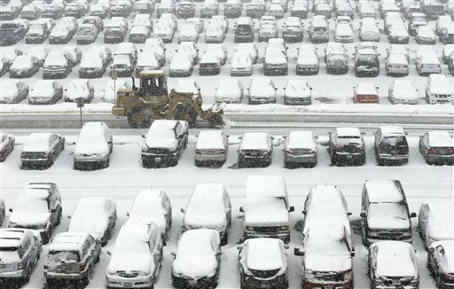 A snow plow clears a parking lot at O&#39;Hare International Airport in Chicago, Tuesday, March 5, 2013. A late winter storm packing up to 10 inches of snow sent officials in weather-hardened Chicago into action Tuesday to prevent a repeat of scenes from two years ago, when hundreds of people in cars and buses were stranded on the city&#39;s marquee thoroughfare during a massive blizzard. &#40;AP Photo&#47;Nam Y. Huh&#41; <span class=meta>(AP Photo&#47; Nam Y. Huh)</span>