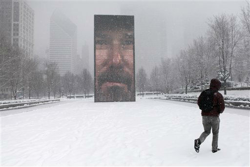 A man walks around the Millennium Park as a snow storm passes through the region Tuesday, March 5, 2013, in Chicago. Chicago was hit Tuesday by a storm expected to dump as much as 10 inches of snow in the area before the end of the day ? the most since the 2011 blizzard and its more than 20 inches of snow. &#40;AP Photo&#47;Kiichiro Sato&#41; <span class=meta>(AP Photo&#47; Kiichiro Sato)</span>