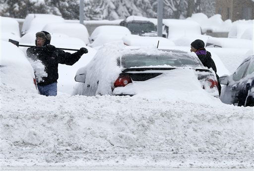 Workers remove snow from cars at an auto dealership Tuesday, March 5, 2013, in Bloomington, Minn. left by a storm that is crawling east from the Dakotas and Minnesota toward Chicago which could bring up to 10 inches of snow in some areas. &#40;AP Photo&#47;Jim Mone&#41; <span class=meta>(AP Photo&#47; Jim Mone)</span>