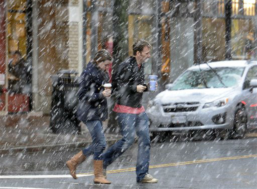"<div class=""meta ""><span class=""caption-text "">A couple crosses King Street in the historic Old Town district of Alexandria, Va., as snow falls, Wednesday, March 6, 2013. After pummeling the nation's midsection with heavy snow, a late-winter storm made its way Wednesday to the nation's capital, where residents braced for the possibility of power outages. As the storm closed in, the federal government said its offices in the Washington, D.C., area would be closed Wednesday. Many major school systems around Washington and Baltimore announced pre-emptive closures as well. (AP Photo/Cliff Owen) (AP Photo/ Cliff Owen)</span></div>"
