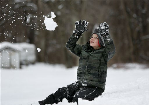 Garrett Strahin, 8, braces for the impact of a snowball thrown by his sister, Katelynn in Masontown, W.Va., on Wednesday, March 6, 2013. A late winter storm dumped nearly a foot of snow Wednesday in West Virginia, closing schools in more than half the state and leaving more than 20,000 customers without power. &#40;AP Photo&#47;David Smith&#41; <span class=meta>(AP Photo&#47; David Smith)</span>
