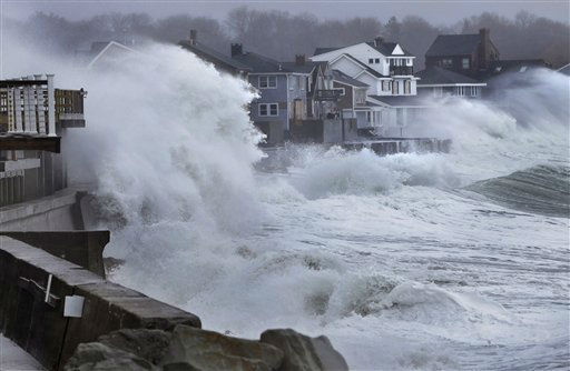 Ocean waves crash over a seawall and into houses along the coast in Scituate, Mass., Thursday, March 7, 2013. A nor&#39;easter is bringing wind-whipped, wet snow to Massachusetts, and coastal flooding is expected in communities still recovering from February&#39;s blizzard. &#40;AP Photo&#47;Steven Senne&#41; <span class=meta>(AP Photo&#47; Steven Senne)</span>