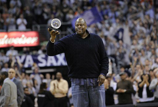 "<div class=""meta ""><span class=""caption-text "">Former NBA and Georgetown basketball player Patrick Ewing acknowledges the crowd after he was recognized with an award during the second half of an NCAA college basketball game between Georgetown and Syracuse, Saturday, March 9, 2013, in Washington. Georgetown won 61-39. (AP Photo/Nick Wass) (AP Photo/ Nick Wass)</span></div>"