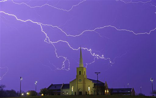 "<div class=""meta ""><span class=""caption-text "">Lightning steaks across the sky behind the Young Meadows Presbyterian Church in Montgomery, Ala., Monday, March 18, 2013. Strong storms moved across much of Alabama on Monday, bringing hail, high winds, and heavy rainfall as a cold front passed through the state. (AP Photo/Dave Martin) (AP Photo/ Dave Martin)</span></div>"