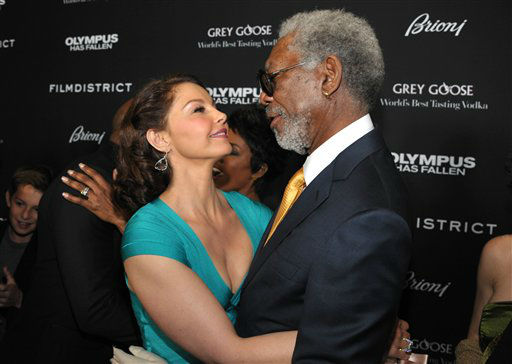 "<div class=""meta image-caption""><div class=""origin-logo origin-image ""><span></span></div><span class=""caption-text"">Ashley Judd, left, and Morgan Freeman arrive at the premiere of ""Olympus Has Fallen"" at the ArcLight Theatre on Monday, March 18, 2013 in Los Angeles. (Photo by John Shearer/Invision/AP) (Photo/John Shearer)</span></div>"
