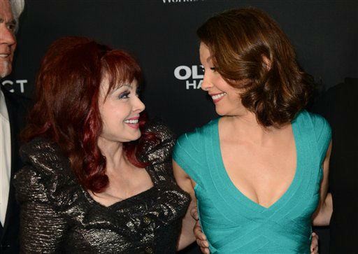 Ashley Judd, right, and her mother Naomi Judd arrive at the LA premiere of &#34;Olympus Has Fallen&#34; at the ArcLight Theatre on Monday, March 18, 2013 in Los Angeles. &#40;Photo by Jordan Strauss&#47;Invision&#47;AP&#41; <span class=meta>(Photo&#47;Jordan Strauss)</span>