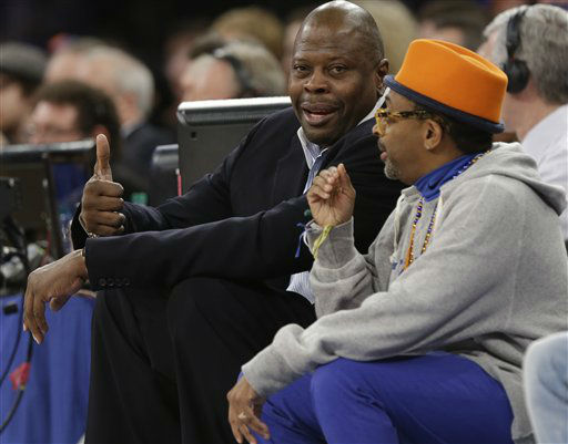 Patrick Ewing, left, talks with Spike Lee during the first half of an NBA basketball game between the New York Knicks and the Orlando Magic Wednesday, March 20, 2013, in New York.  &#40;AP Photo&#47;Frank Franklin II&#41; <span class=meta>(AP Photo&#47; Frank Franklin II)</span>