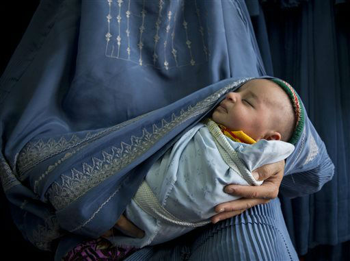 "<div class=""meta image-caption""><div class=""origin-logo origin-image ""><span></span></div><span class=""caption-text"">In this Thursday, April 11, 2013 photo, an Afghan woman holds her newly born baby wrapped in her burqa  as she waits to get in line to try on a new burqa in a shop in the old town of Kabul, Afghanistan. Despite advances in women?s rights, Afghanistan remains a deeply conservative country and most women continue to wear the Burqa. But tradesmen say times are changing in Kabul at least, with demand for burqas declining as young women going to school and taking office jobs refuse to wear the cumbersome garments. (AP Photo/Anja Niedringhaus) (AP Photo/ Anja Niedringhaus)</span></div>"