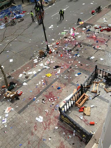 This photo provided by Bruce Mendelsohn shows the scene after two explosions occurred during the 2013 Boston Marathon in Boston, Monday, April 15, 2013. Two explosions shattered the euphoria of the Boston Marathon finish line on Monday, sending authorities out on the course to carry off the injured while the stragglers were rerouted away from the smoking site of the blasts. &#40;AP Photo&#47; Bruce Mendelsohn&#41; MANDATORY CREDIT <span class=meta>(AP Photo&#47; Bruce Mendelsoh)</span>