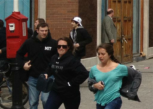 This Monday, April 15, 2013, shows a man who was dubbed Suspect No. 2 in the Boston Marathon bombings by law enforcement, in the upper center of the frame, wearing a white baseball cap, walking away from the scene of the explosions. The FBI identified him as 19-year-old college student Dzhokhar Tsarnaev, who along with his brother Tamerlan, 26, previously known as Suspect No. 1, killed an MIT police officer, severely wounded another lawman and hurled explosives at police in a car chase and gun battle during a night of violence, early Friday, April 19, 2013. Tamerlan Tsarnaev was killed overnight, officials said, while his brother Dzhokhar remains at large. &#40;AP Photo&#47;David Green&#41; EXCLUSIVE CONTENT-SPECIAL RATES APPLY FOR NON-AP MEMBERS AND  SUBSCRIBERS. <span class=meta>(AP Photo&#47; David Green)</span>