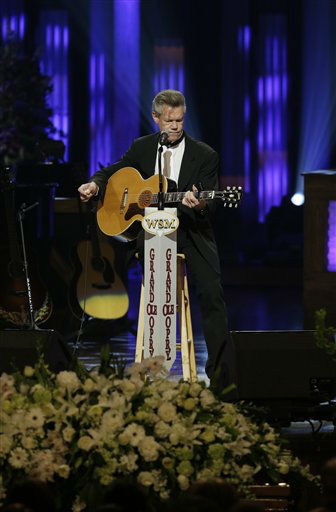 "<div class=""meta image-caption""><div class=""origin-logo origin-image ""><span></span></div><span class=""caption-text"">Randy Travis performs during the funeral for country music star George Jones in the Grand Ole Opry House on Thursday, May 2, 2013, in Nashville, Tenn. Jones, one of country music's biggest stars who had No. 1 hits in four separate decades, died April 26.  (AP Photo/Mark Humphrey, Pool) (AP Photo/ Mark Humphrey)</span></div>"