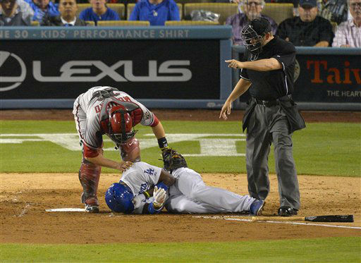 "<div class=""meta ""><span class=""caption-text "">Los Angeles Dodgers' Yasiel Puig, below, is seen to by Arizona Diamondbacks catcher Miguel Montero after being grazed by a pitch as home plate umpire Clint Fagan signals during the sixth inning of their baseball game, Tuesday, June 11, 2013, in Los Angeles.  (AP Photo/Mark J. Terrill) (AP Photo/ Mark J. Terrill)</span></div>"