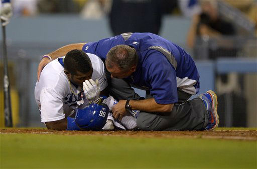 "<div class=""meta image-caption""><div class=""origin-logo origin-image ""><span></span></div><span class=""caption-text"">Los Angeles Dodgers' Yasiel Puig, left, is seen to by a trainer after being grazed by a pitch during the sixth inning of their baseball game against the Arizona Diamondbacks, Tuesday, June 11, 2013, in Los Angeles.  (AP Photo/Mark J. Terrill) (AP Photo/ Mark J. Terrill)</span></div>"