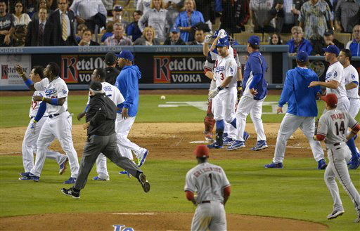 "<div class=""meta image-caption""><div class=""origin-logo origin-image ""><span></span></div><span class=""caption-text"">Members of the Los Angeles Dodgers and the Arizona Diamondbacks run on to the field during a scuffle in the seventh inning of their baseball game, Tuesday, June 11, 2013, in Los Angeles.  (AP Photo/Mark J. Terrill) (AP Photo/ Mark J. Terrill)</span></div>"
