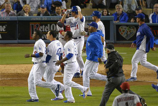 Members of the Los Angeles Dodgers and the Arizona Diamondbacks run on to the field during a scuffle in the seventh inning of their baseball game, Tuesday, June 11, 2013, in Los Angeles.  &#40;AP Photo&#47;Mark J. Terrill&#41; <span class=meta>(AP Photo&#47; Mark J. Terrill)</span>