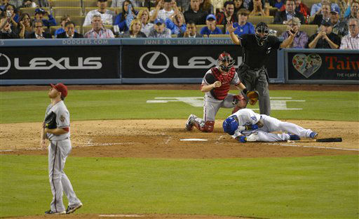 "<div class=""meta ""><span class=""caption-text "">Los Angeles Dodgers' Yasiel Puig, below, is seen to by Arizona Diamondbacks catcher Miguel Montero, second from left, after being hit by a pitch as home plate umpire Clint Fagan signals and starting pitcher Ian Kennedy looks on during the sixth inning of their baseball game, Tuesday, June 11, 2013, in Los Angeles.  (AP Photo/Mark J. Terrill) (AP Photo/ Mark J. Terrill)</span></div>"