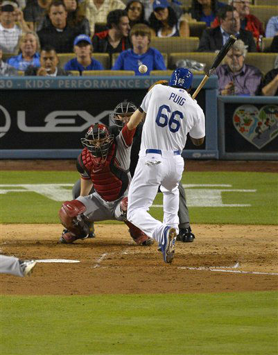 Los Angeles Dodgers&#39; Yasiel Puig, right, is hit by a pitch as Arizona Diamondbacks catcher Miguel Montero catches during the sixth inning of their baseball game, Tuesday, June 11, 2013, in Los Angeles.  &#40;AP Photo&#47;Mark J. Terrill&#41; <span class=meta>(AP Photo&#47; Mark J. Terrill)</span>