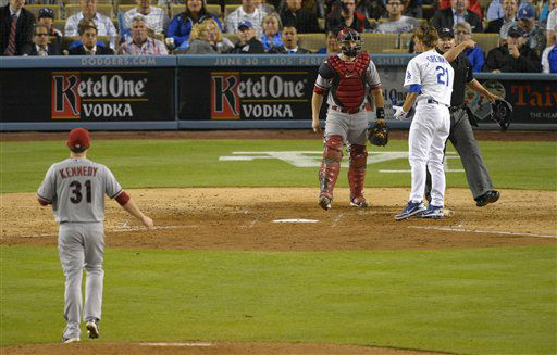 Arizona Diamondbacks starting pitcher Ian Kennedy, left, is thrown out of the game by home plate umpire Clint Fagan, right, as catcher Miguel Montero, second from left, looks on after hitting Los Angeles Dodgers&#39; Zack Greinke, second from right, with a pitch during the seventh inning of their baseball game, Tuesday, June 11, 2013, in Los Angeles.  &#40;AP Photo&#47;Mark J. Terrill&#41; <span class=meta>(AP Photo&#47; Mark J. Terrill)</span>