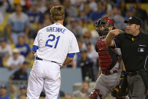 "<div class=""meta ""><span class=""caption-text "">Arizona Diamondbacks starting pitcher Ian Kennedy, not seen, is thrown out of the game by home plate umpire Clint Fagan, right, as catcher Miguel Montero, center, looks on after hitting Los Angeles Dodgers' Zack Greinke, left, with a pitch during the seventh inning of their baseball game, Tuesday, June 11, 2013, in Los Angeles.  (AP Photo/Mark J. Terrill) (AP Photo/ Mark J. Terrill)</span></div>"