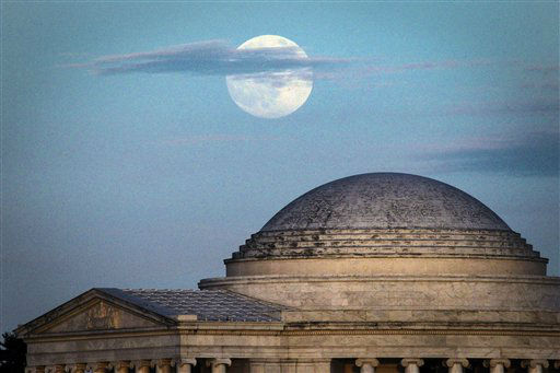 "<div class=""meta image-caption""><div class=""origin-logo origin-image ""><span></span></div><span class=""caption-text"">A full moon rises behind the Jefferson Memorial in Washington Saturday, June 22, 2013. The larger than normal moon called the ""Supermoon"" happens only once this year as the moon on its elliptical orbit is at its closest point to earth. (AP Photo/J. David Ake) (AP Photo/ J. David Ake)</span></div>"