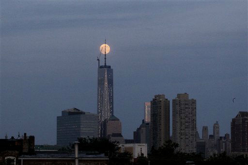 "<div class=""meta ""><span class=""caption-text "">The moon is seen in its waxing gibbous stage as it rises over Lower Manhattan, including One World Trade Center, center, seen from The Heights neighborhood of Jersey City, N.J., Saturday, June 22, 2013. The moon, which will reach its full stage on Sunday, is expected to be seen 13.5 percent larger than usual during a phenomenon known as supermoon. (AP Photo/Julio Cortez) (AP Photo/ Julio Cortez)</span></div>"