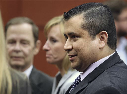 "<div class=""meta image-caption""><div class=""origin-logo origin-image ""><span></span></div><span class=""caption-text"">George Zimmerman leaves court with his family after Zimmerman's not guilty verdict was read in Seminole Circuit Court in Sanford, Fla. on Saturday, July 13, 2013. Jurors found Zimmerman not guilty of second-degree murder in the fatal shooting of 17-year-old Trayvon Martin in Sanford, Fla. (AP Photo/Joe Burbank, Pool) (AP Photo/ Joe Burbank)</span></div>"