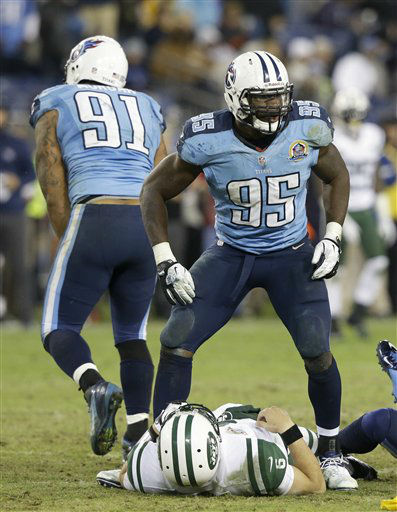 "<div class=""meta ""><span class=""caption-text "">New York Jets quarterback Mark Sanchez (6) lies on the ground after getting a pass away and being hit by Tennessee Titans defensive end Kamerion Wimbley (95) in the fourth quarter of an NFL football game on Monday, Dec. 17, 2012, in Nashville, Tenn. At left is Titans defensive end Derrick Morgan (91). The Titans won 14-10. (AP Photo/Wade Payne) (AP Photo/ Wade Payne)</span></div>"